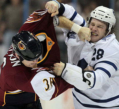 There's plenty of goals in this game, but also a heavyweight fight between Eric Boulton (36) and Colton Orr (28). (AP)