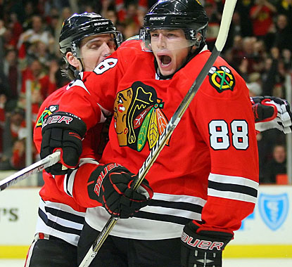Patrick Kane (88) celebrates his first goal since November 30 with Patrick Sharp. (US Presswire)