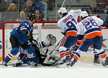 John Tavares wrists the puck in the net over goalie Craig Anderson with 68 seconds left in overtime. (Getty Images)