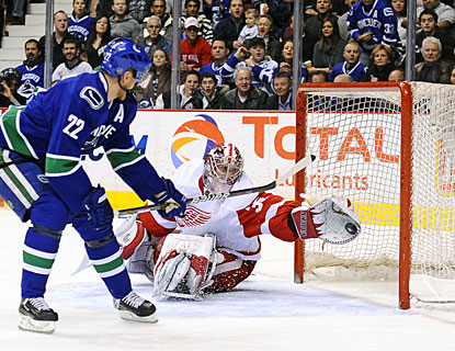 Jimmy Howard makes a spectacular save on what looks like a sure goal by Daniel Sedin. (Getty Images)