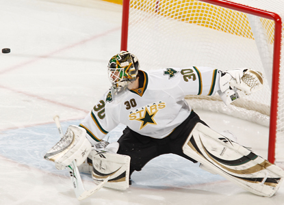 Stars goalie Andrew Raycroft stops a shot en route to 26 saves against the Wild and his second shutout of the season. (AP)
