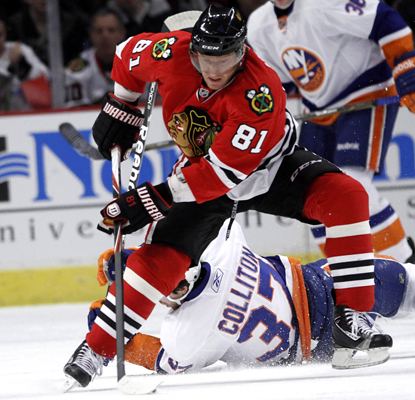 Marian Hossa stickhandles against the Islanders during his three-point performance of one goal and two assists. (AP)