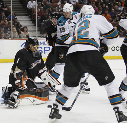 Ducks goalie Jonas Hiller makes a stop on Patrick Marleau as he works toward a 37-save shutout. (AP)
