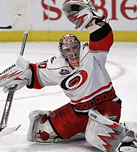Goalie Cam Ward is one of the dwindling connections to Carolina's Cup champions. (AP)