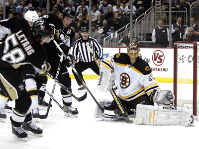 Tuukka Rask stops 23 shots, including this one from the Penguins' Kris Letang. (Getty Images)