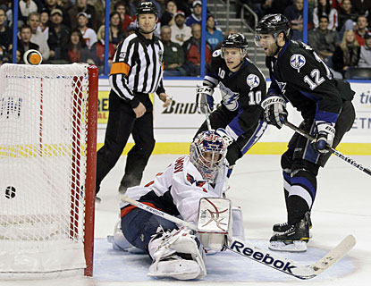 Simon Gagne (12) caps the scoring for the Lightning in the second period with his fourth goal this season. (AP)