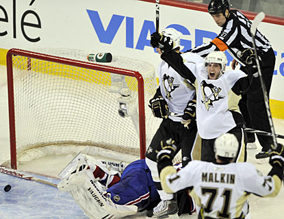 Alex Goligoski celebrates his second goal of the game and the fourth for Pittsburgh in the contest. (AP)