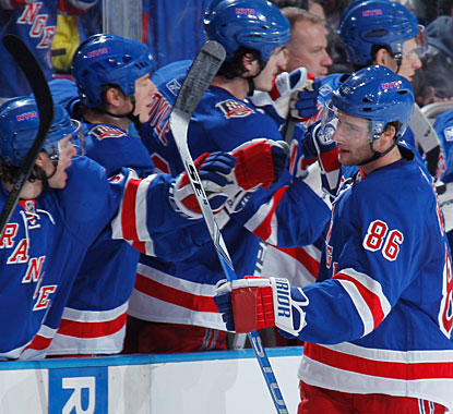 The bench congratulates Wojtek Wolski who scores his first goal with the Rangers. (Getty Images)