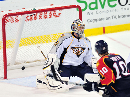 David Booth scores the game-winning goal for the Panthers past Predators goalie Pekka Rinne. (US Presswire)