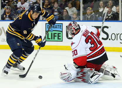 Sabres winger Cody McCormick closes in on Hurricanes goalie Cam Ward before scoring in the second period. (US Presswire)