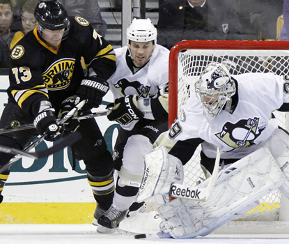 Penguins goalie Marc-Andre Fleury shuts the door on Michael Ryder of the Bruins for one of his 44 saves. (AP)