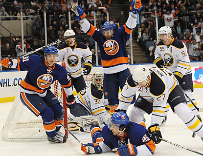 John Tavares and the Islanders get the celebration going after No. 91 nets his third goal in less than six minutes. (AP)