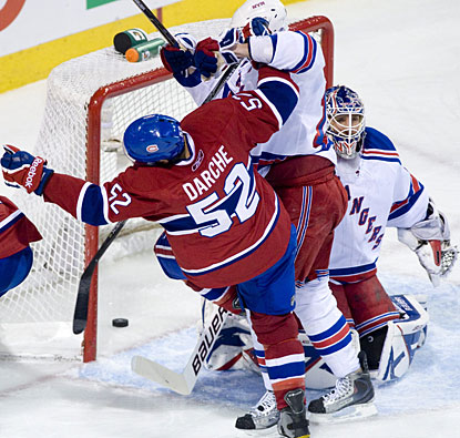 The action is pretty physical in front of goalie Henrik Lundqvist as Roman Hamrlik (not shown) scores Montreal's second goal. (AP)