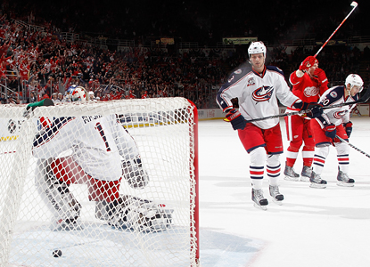 Johan Franzen celebrates his game-winning goal in overtime against Blue Jackets goalie Steve Mason. (Getty Images)
