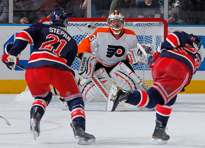 Chris Drury (23) of the Rangers shoots the puck against Flyers goalie Brian Boucher. (Getty Images)