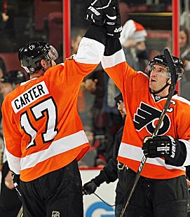 Jeff Carter and captain Mike Richards (right) have helped make the Flyers the East's highest-scoring team. (Getty Images)