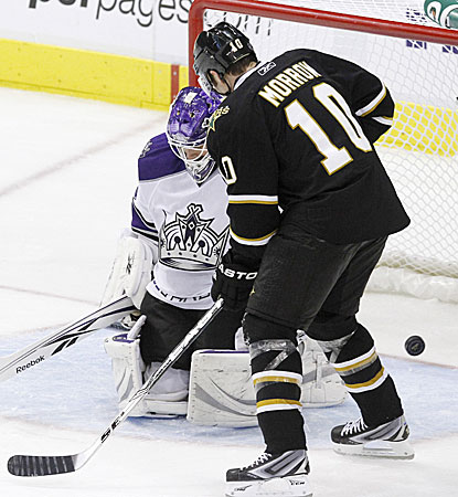 Stars left winger Brenden Morrow watches as the puck slips by Kings goalie Jonathan Bernier. (AP)