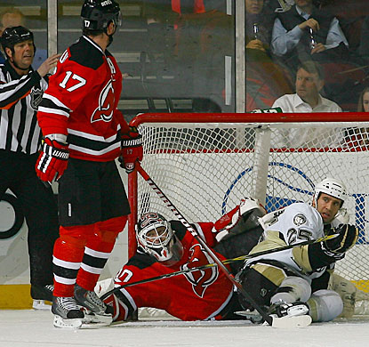 Martin Brodeur stops pucks and players alike en route to his fourth shutout this season. (Getty Images)