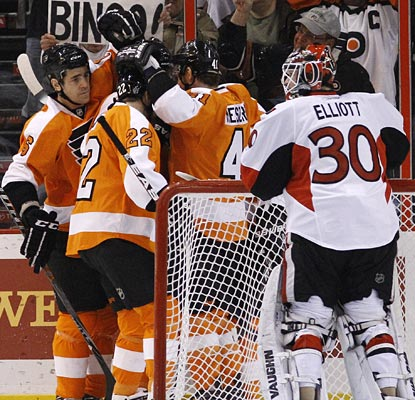 The Flyers celebrate a Danny Briere goal behind the net as Senators goalie Brian Elliott is left to look on.  (AP)