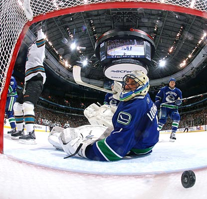 Roberto Luongo turns around in time to see Logan Couture's shot trickle into the net.  (Getty Images)