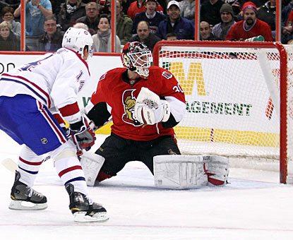 Tomas Plekanec lifts one high on Brian Elliott for his second goal in the game and 16th this season. (Getty Images)