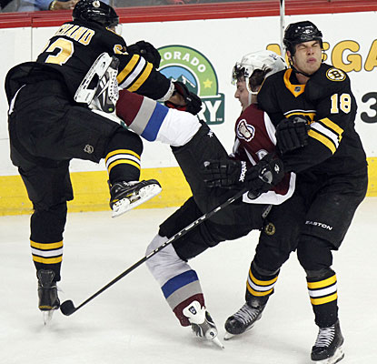 Brad Marchand collides with Colorado's Matt Duchene as Nathan Horton (18) also reacts after the impact. (AP)
