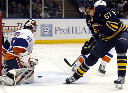 Sabres defenseman Tyler Myers puts the puck past Islanders goalie Rick DiPietro in the third period. (AP)