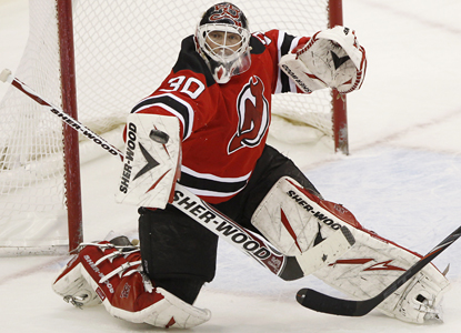 Devils goalie Martin Brodeur deflects a shot for one of his 24 saves against the Panthers. (AP)
