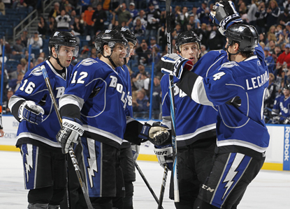 Simon Gagne (12) of the Lightning celebrates his second-period goal against the Thrashers with teammates. (Getty Images)