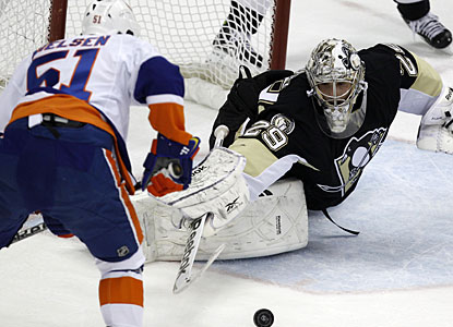 Marc-Andre Fleury makes sure Frans Nielsen does not get to this rebound to preserve his shutout. (AP)