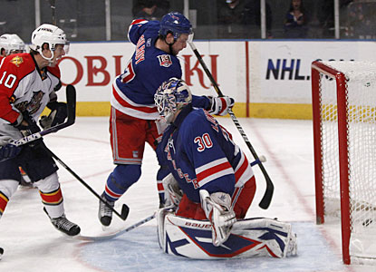 Henrik Lundqvist has no idea the puck has dropped behind him and into the net off the back of teammate Artem Anisimov. (AP)