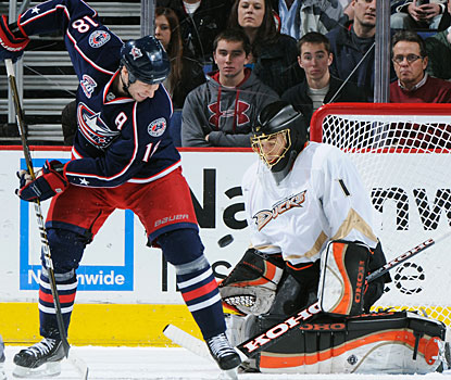 All-Star goalie Jonas Hiller denies R.J. Umberger a scoring opportunity to collect another win. (Getty Images)