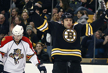 While Milan Lucic celebrates his goal for Boston, Michael Frolik can't hide his disappointment in the background. (AP)