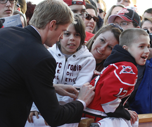 Eric Staal of the Hurricanes signs an autograph before the NHL All-Star Skills Competition. (AP)