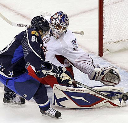 Team Staal goalie Henrik Lundqvist makes a save on Team Lidstrom's Patrick Kane in the third period. (US Presswire)