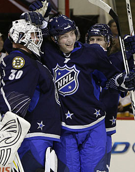 Tim Thomas and Matt Duchene celebrate after holding on to win the All-Star Game. (AP)