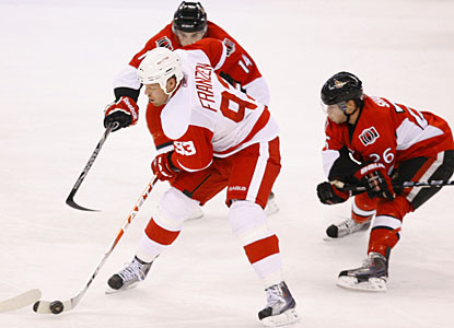 Johan Franzen gets his accomplishment by scoring two goals in the first period and three in the third. (Getty Images)