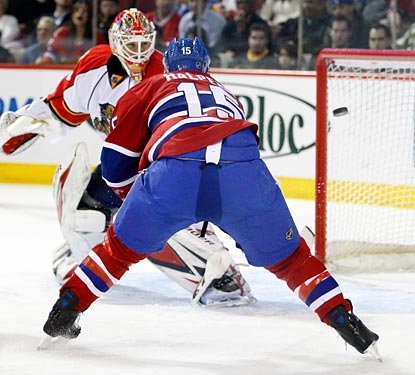 Jeff Halpern tips the puck in past Tomas Vokoun for the first of three Canadiens goals in the game.  (Getty Images)