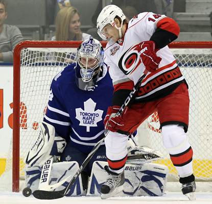 Leafs goalie James Reimer makes a stop on Hurricanes left wing Sergei Samsonov en route to his first NHL shutout. (AP)