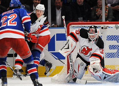 Devils goalie Martin Brodeur makes one of his 25 saves in a win against the Rangers. (AP)