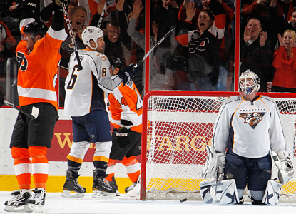 Ville Leino, left, celebrates his second goal of the game on Nashville goalie Anders Lindback. (Getty Images)