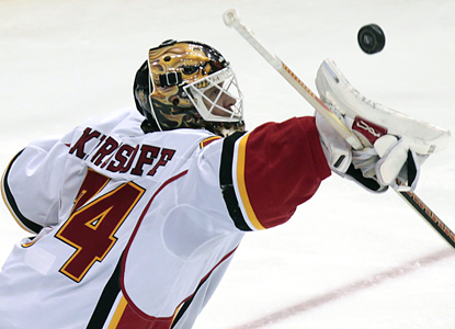 Flames goalie Miikka Kiprusoff blocks a shot as he makes 22 saves for the win. (AP)