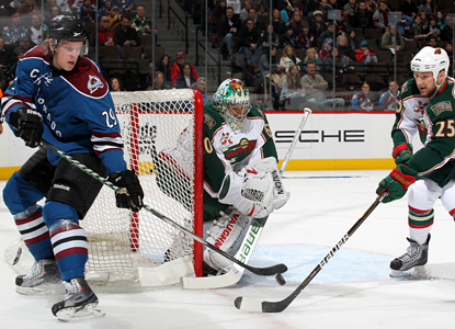Ryan Stoa (29) tries to tip the puck past Wild goalie Jose Theodore but Theodore ends up the winner with 38 saves. (Getty Images)