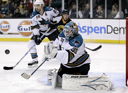 Sharks defenseman Dan Boyle helps goalie Antti Niemi hold off the Bruins and post a shutout. (AP)