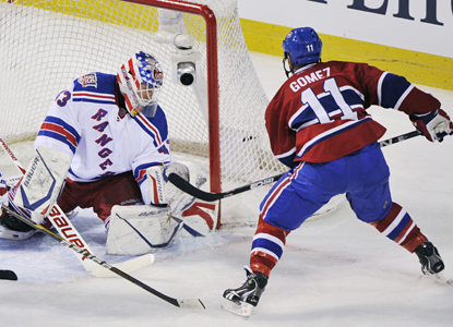 Scott Gomez scores his seventh goal of the season on Rangers' goalie Martin Biron in the Canadiens' win. (AP)