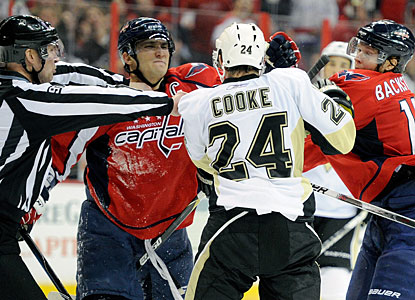 Alex Ovechkin and Nicklas Backstrom go after Matt Cooke, who took a knee-to-knee hit on Ovechkin. (Getty Images)
