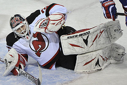 Martin Brodeur, who does get credit for his 615th career win, grimaces in pain after making a save. (AP)