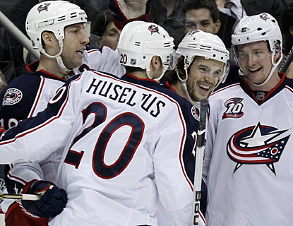 Blue Jackets players have reason to be happier after losing 7-2 to Pittsburgh the last time they met in early December. (AP)