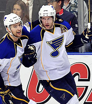 Alex Pietrangelo helps David Backes (right) celebrate a goal in a win at Florida on Tuesday. (AP)
