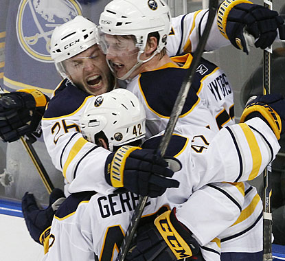 Thomas Vanek (26) and Nathan Gerber celebrate Tyler Myers' winner just seconds before time was about to expire. (AP)